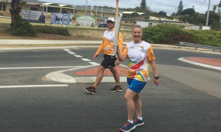 AURA members take pride with Queen's Baton